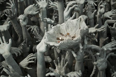 a Part of Statue of white Buddha surrounded gold pattern,Wat Rong Khun, Chiangrai photo