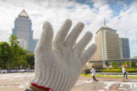 left hand: white glove on left hand