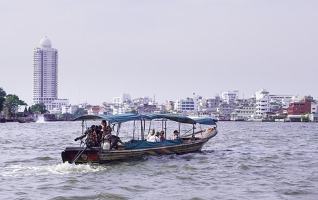satisfy: Tourists satisfy to travel in Thailand by longtail boat. Foating on Chao Praya river is one of most favorite in Bangkok.