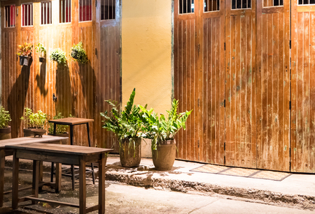Classic old wooden doors in Thailand. Night view on vintage and retro style.