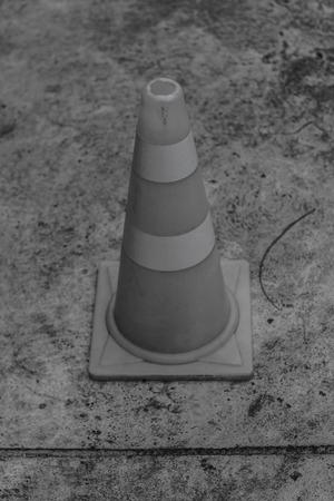 circumspect: cone on concrete Stock Photo