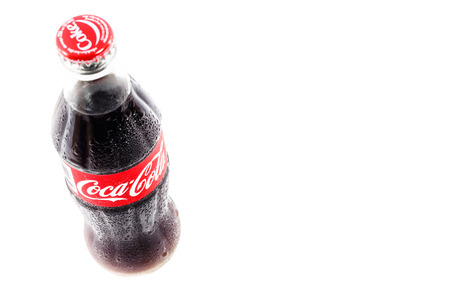 carbonated: PHUKET, THAILAND - DECEMBER 25, 2014. Glass bottle of Coca-Cola Classic. Coca-Cola is one of the worlds favorite carbonated beverages