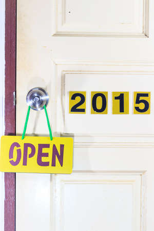 20 year old: open the old 2014 door to new life in 2015, leave every thing bad in 2014 and move to new good thing in 2015