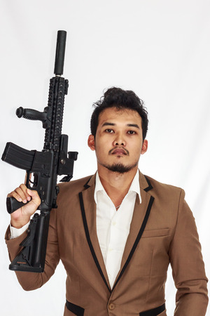 Mature Business Man Holding Gun photo