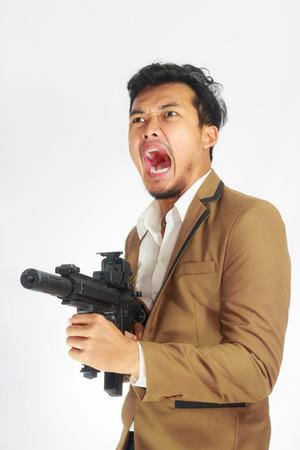 man holding gun: Mature Business Man Holding Gun Stock Photo