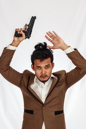 holding gun: young Business Man Holding Gun, surrender. Stock Photo