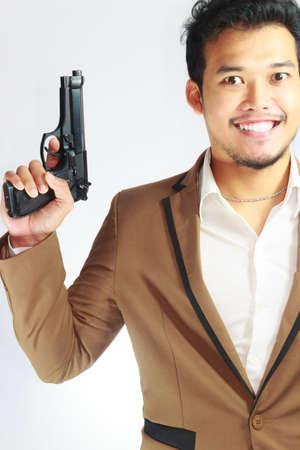 holding gun: Mature Business Man Holding Gun Stock Photo