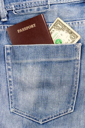 customs official: passport and cash in jeans pocket