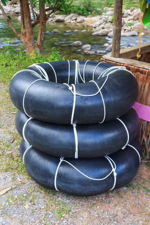 river side: black life ring on river side Stock Photo