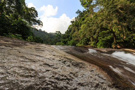 phrom: Waterfall in tropical forest. Mountain river, stones with moss,Thailand