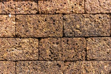 brown rough stone wall full frame.grunge