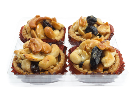 Tart cashew and raisin isolated on a white background.