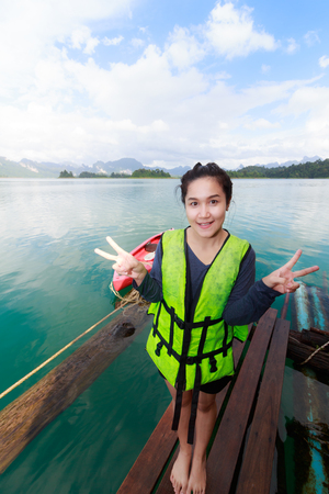 Woman on Khao Sok National Park, Mountain and Lake in Southern Thailand.