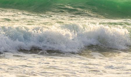 A beautiful blue wave breaks in the ocean