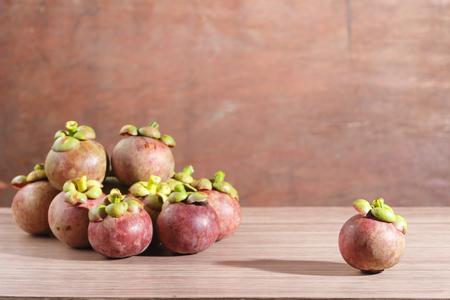 Mangosteen on wooden floor.Fresh Fruits warm tone.