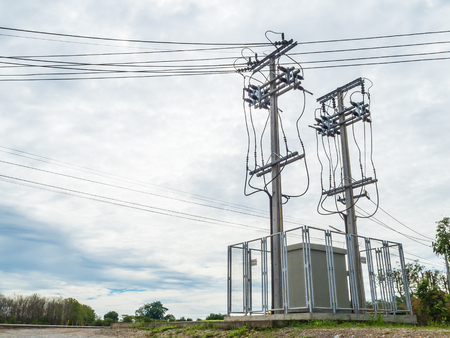 amp tower: Electricity Substation and Twin High Voltage Pole with Cloudy Sky Background Stock Photo