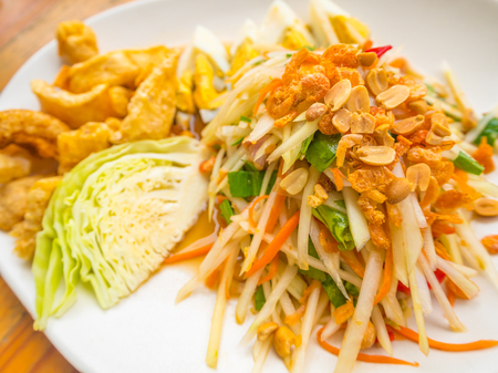 side dishes: Famous Thai food, papaya salad or what we called Somtum in Thai with boiled egg, pork rind and cabbage are side dishes