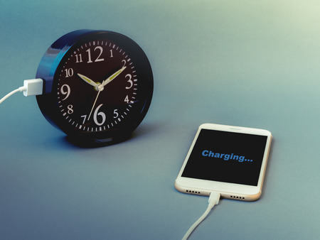 game time: Smart phone charging time from clock with text Charging on screen, Vintage filter. Concept of smart phone take much time, smart phone addiction, phubbing, game or social network issues. Stock Photo
