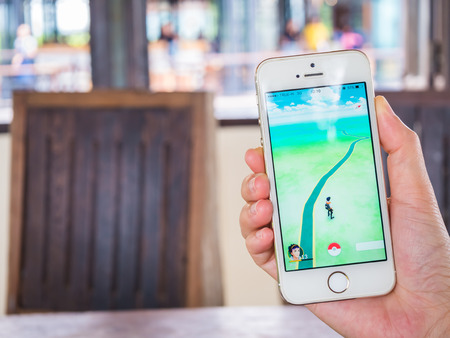 CHIANGRAI, THAILAND - August 17, 2016: Person holding mobile phone and showing Pokemon Go game application. Pokemon Go is a location-based augmented reality mobile game. Editorial