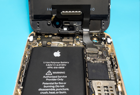 ic: Chiangrai, Thailand: March 14, 2017 - Apple iPhone disassembled for repair and showing components inside. Selective focus