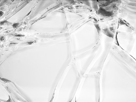 Cracked glass texture on white background. Isolated realistic cracked glass effect.