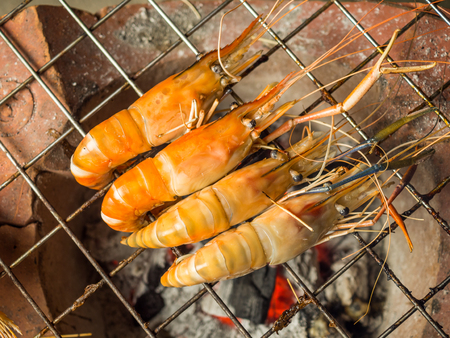 Top view of grilled shrimps (Giant Malaysian Prawn) on flaming grill Stock Photo