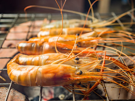 Grilled shrimps (Giant Malaysian Prawn) on flaming grill