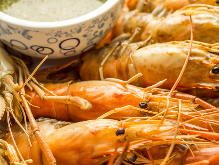 Close up image of Grilled shrimps with Thai culture seafood sauce Stock Photo