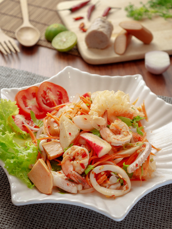 Thai yum salad hot and spicy with shrimp, squid, Vietnamese sausage, sausage, krab sticks and vegetables. Yum salad is a Thai local food, Spicy sour and sweet taste. Reklamní fotografie