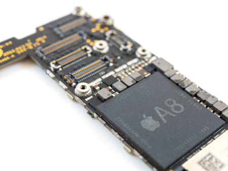 Chiang Rai, Thailand: April 12, 2017 - Close-up image of Apple A8 Microprocessor (CPU) chip on Apple iPhone 6 logic board. Selective focus