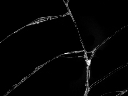 Cracked glass texture on black background. Isolated realistic cracked glass effect.