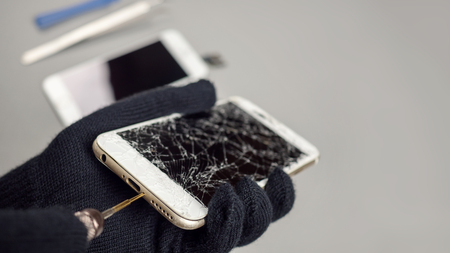 Technician or engineer opening broken smartphone for repair or replace new part on desk with copy space Stok Fotoğraf