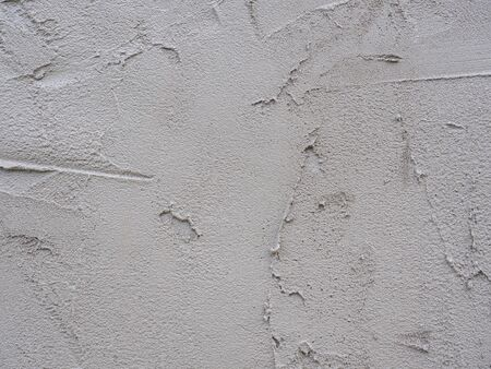 Close-up shot of rough unfinished plaster concrete texture. Use as a background image