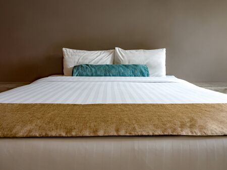 Empty double bed in luxury and natural style bedroom is decorated with loft style. Stock fotó