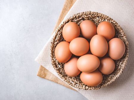 Top view and close up image of  organic chicken eggs are one of the food ingredients on the restaurant table in the kitchen to prepare for cookingwith copy space. Organic chicken eggs food ingredients concept Stock fotó