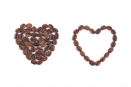Set of roasted coffee beans arranged in heart shape solid and outline on white background. Coffee, food ingredient and valentines day concept.  Stock fotó