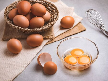 Close up image of three eggs yolk in clear bowl are one of the food ingredients on the restaurant table in the kitchen to prepare for cooking. Organic chicken eggs food ingredients concept Stock fotó