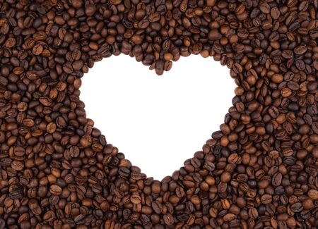 Pattern background of roasted coffee beans leave blank space in heart shape on white background. Coffee lover, food ingredient and valentines day concept.