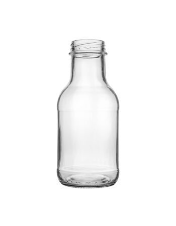 Empty transparent glass bottle for canning and preserving isolated on white background.