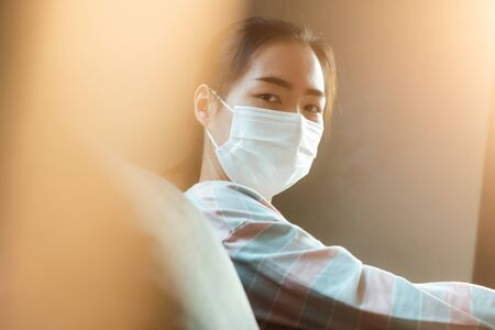Beautiful Asian woman wearing medical hygiene protective mask for health care from Coronavirus (COVID-19). Health care, quarantine and prevent from risk of Coronavirus (COVID-19) concept.