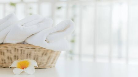 Laundry white towel with basket in bathroom with copy space. 免版税图像