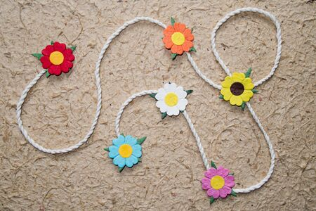 Colorful Artificial flower on mulberry paper background Stock Photo - 10396305