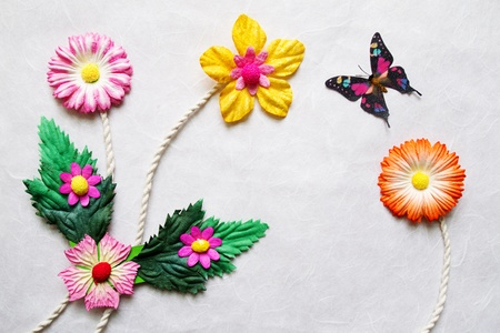 Colorful Artificial flower on mulberry paper background photo