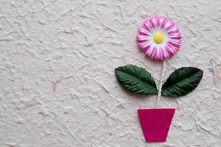 Artificial flower on mulberry  paper background photo