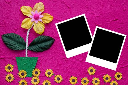 Frame on artificial flowers  paper photo