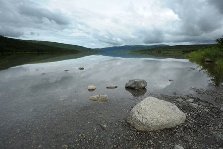 denali: stone on wonder lake shore, denali national park Stock Photo
