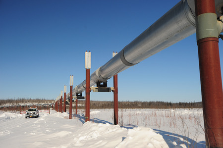 a service truck with alaska oil pipeline in winter photo