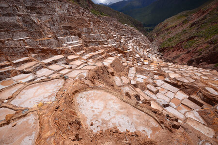 evaporation: Inca ancient salt farm produced by evaporation in Peru Stock Photo