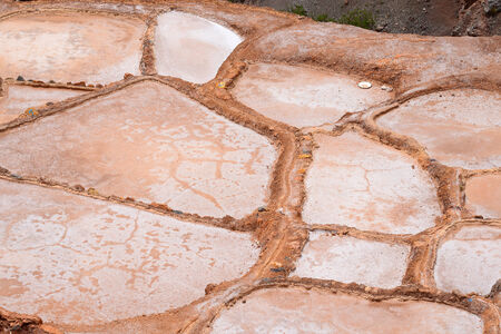 evaporation: Inca ancient salt farm produced by evaporation in Peru Stock Photo