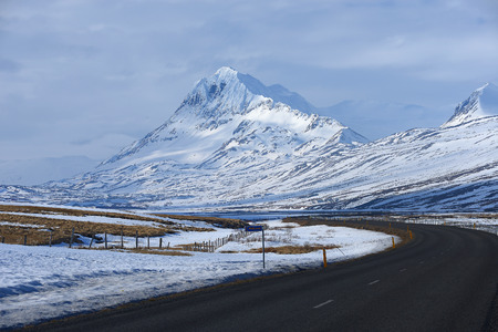 mountain in iceland with road photo